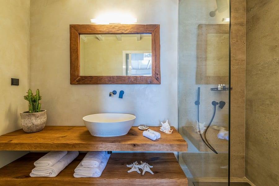 modern inside wooden bathroom sink with glass shower